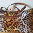 Ženska torbica s tigrastim vzorcem