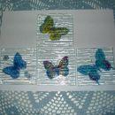 Metuljčki na steklenih podstavkih