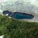 Nad Rjavim jezerom, blizu mesta vstopa v steno